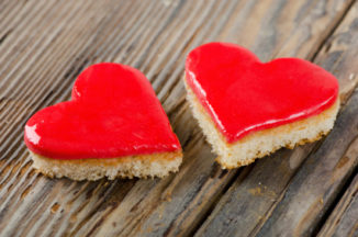 Two  valentine cakes on a wooden table